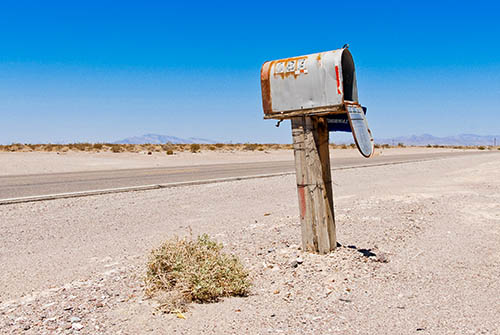 Battered letterbox by the roadside in the US desert
